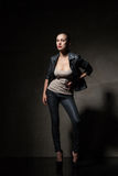 Attractive woman in black leather jacket and pants Stock Images