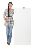 Attractive woman with blank sheet smiling Stock Image