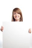 Attractive woman with blank sign. Smiling. Stock Photos