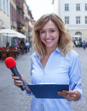 Attractive woman with blond hair asking people Royalty Free Stock Photos