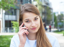 Attractive woman with blond hair listening at phone Stock Image