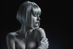 Attractive woman with a blond wig on her head Stock Images