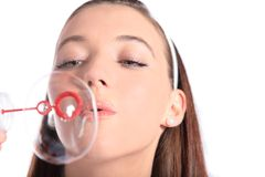 Attractive woman blows bubbles Royalty Free Stock Photos
