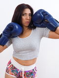 Attractive woman with blue boxing gloves. Seductive Asian woman wearing blue boxing gloves Stock Photos
