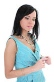Attractive woman in blue dreaming over white Royalty Free Stock Photography
