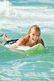 Attractive Woman Bodyboards On Surfboard Royalty Free Stock Images