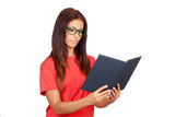 Attractive woman with a book and glasses reading Stock Photography