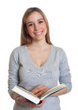 Attractive woman with book Royalty Free Stock Images