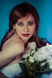 Attractive woman with bouquet of white roses Royalty Free Stock Images