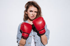 Attractive woman boxer over white background Stock Image