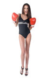 Attractive woman in boxing gloves shouts Royalty Free Stock Photography