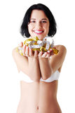 Attractive woman in bra with measuring tapes. Royalty Free Stock Photography