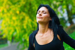 Attractive woman breathing outside Royalty Free Stock Photo
