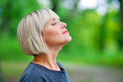Attractive woman breathing and relaxing Royalty Free Stock Photo