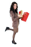 Attractive woman in brown cardigan with presents Stock Photography