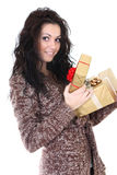Attractive woman in brown cardigan with presents Royalty Free Stock Image