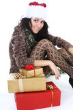Attractive woman in brown cardigan with presents Stock Photo