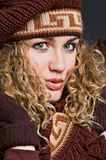 Attractive woman in brown scarf and cap Stock Images