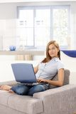 Attractive woman browsing internet at home Stock Photo