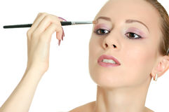 Attractive woman with brush Stock Photography
