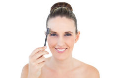 Attractive woman brushing her eyebrow Stock Image