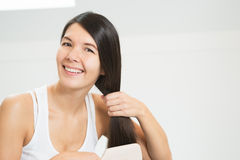 Attractive woman brushing her hair Stock Images