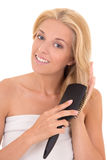 Attractive woman brushing her hair on white background Royalty Free Stock Image