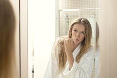 Attractive woman Brushing her teeth in Bathroom Royalty Free Stock Photography