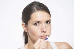 Attractive woman brushing her teeth Royalty Free Stock Photos