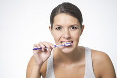 Attractive woman brushing her teeth Royalty Free Stock Image