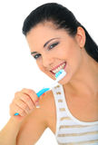 Attractive Woman Brushing Teeth Isolated. Attractive young woman brushing her teeth. isolated on white stock photography