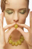 Attractive woman with bunch of grapes Royalty Free Stock Photos