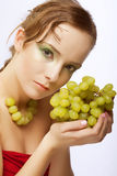 Attractive woman with bunch of grapes Royalty Free Stock Image