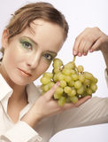 attractive woman with bunch of grapes Stock Photos