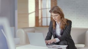 Attractive woman business suit working in office, using laptop. Stock footage stock footage