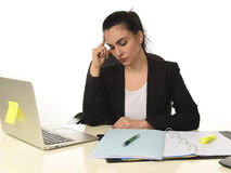 Attractive woman in business suit working tired and bored in office computer desk looking sad Stock Photography
