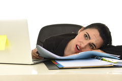 Attractive woman in business suit working tired and bored in office computer desk looking sad Stock Image
