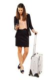Attractive Woman on Business Trip Reading SMS Stock Photo