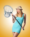 The attractive woman in butterfly catch Royalty Free Stock Photos