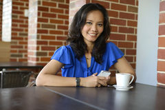 Attractive woman in cafe Stock Image