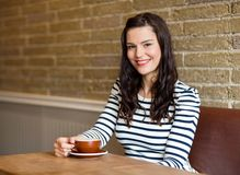 Attractive Woman in Cafe with Coffee Stock Images