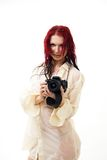 Attractive woman with camera Royalty Free Stock Images