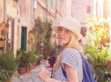 Attractive woman with camera sightseeing in european town Royalty Free Stock Images