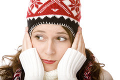 Attractive woman with cap and scarf holding cheeks Stock Photos