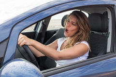 Attractive woman in car singing stock photo