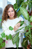 Attractive woman caring for plants Royalty Free Stock Photography