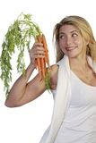 Attractive woman with carrots Royalty Free Stock Image