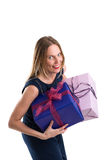 Attractive woman carrying big gift packages, isolated on white Stock Images