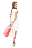 Attractive woman carrying shopping bags while walking Royalty Free Stock Photography