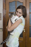 Attractive woman with a cat Stock Photo